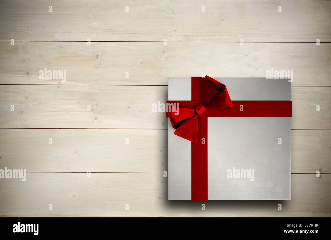Composite image of christmas present with bow - Stock Image