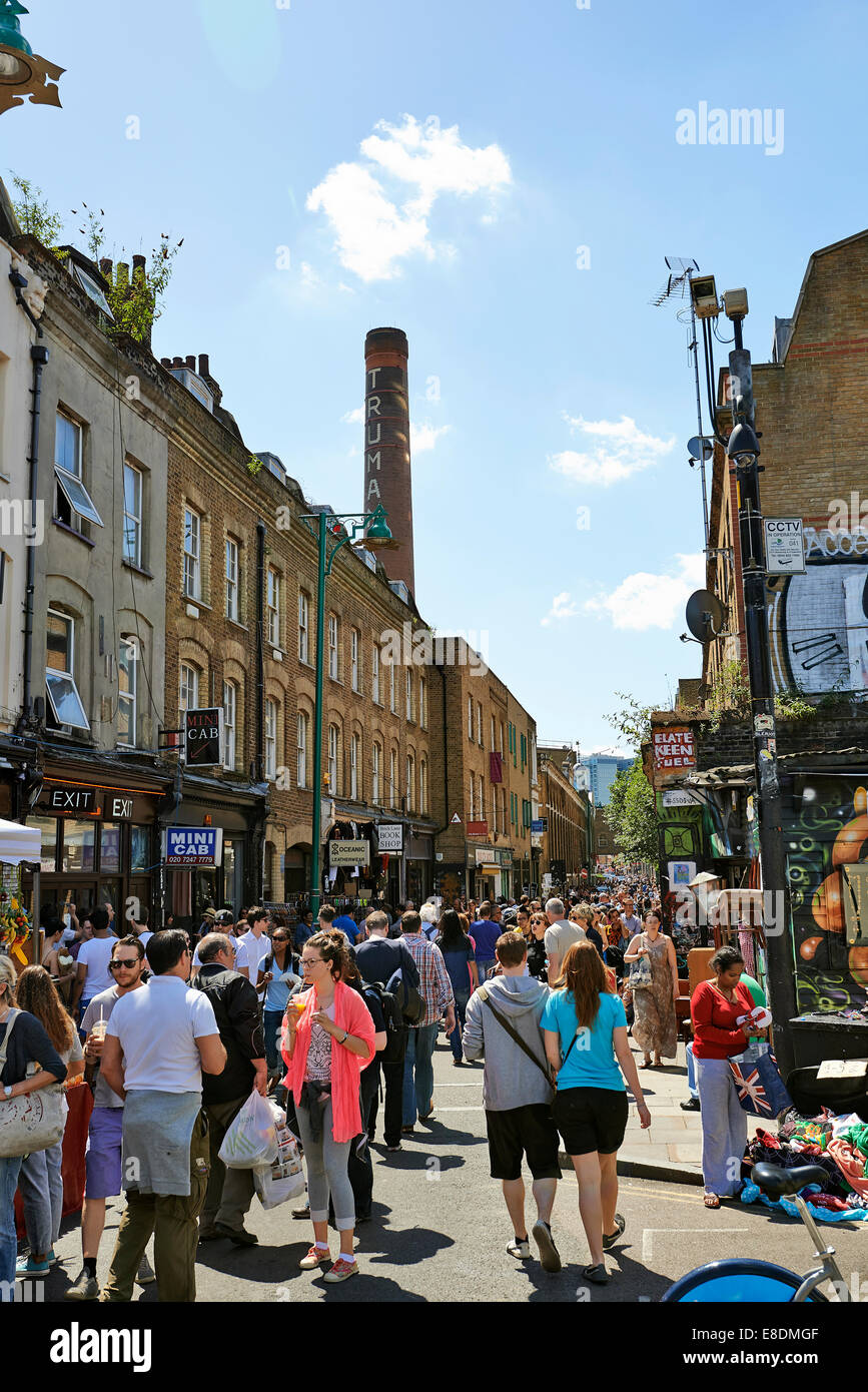 LONDON - JUNE 08, 2014: Tourists in Brick Lane on a busy sunny Sunday on June 08, 2014 in London. Stock Photo