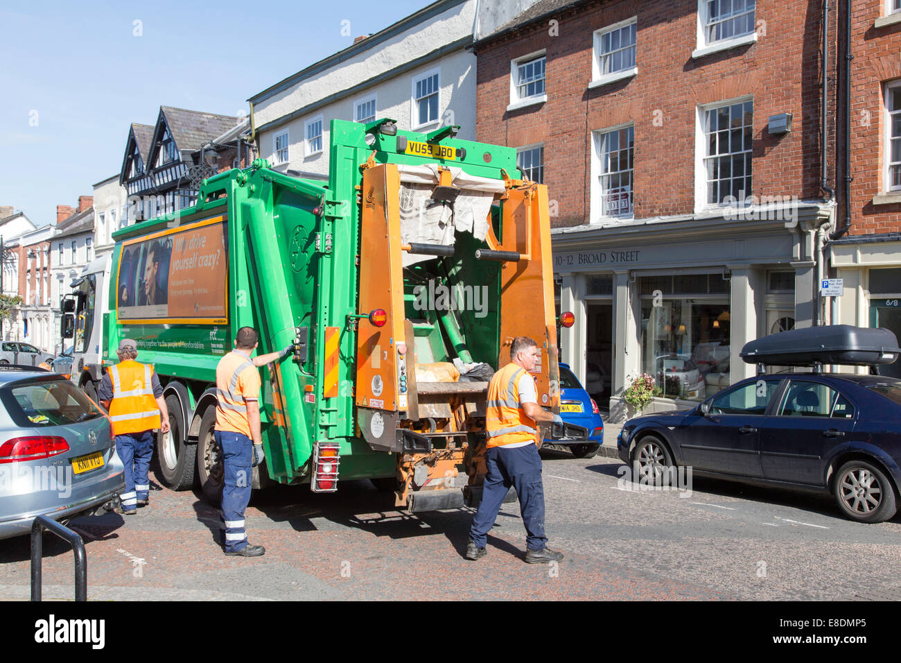 Refuse collectors in town center collection, England, UK - Stock Image