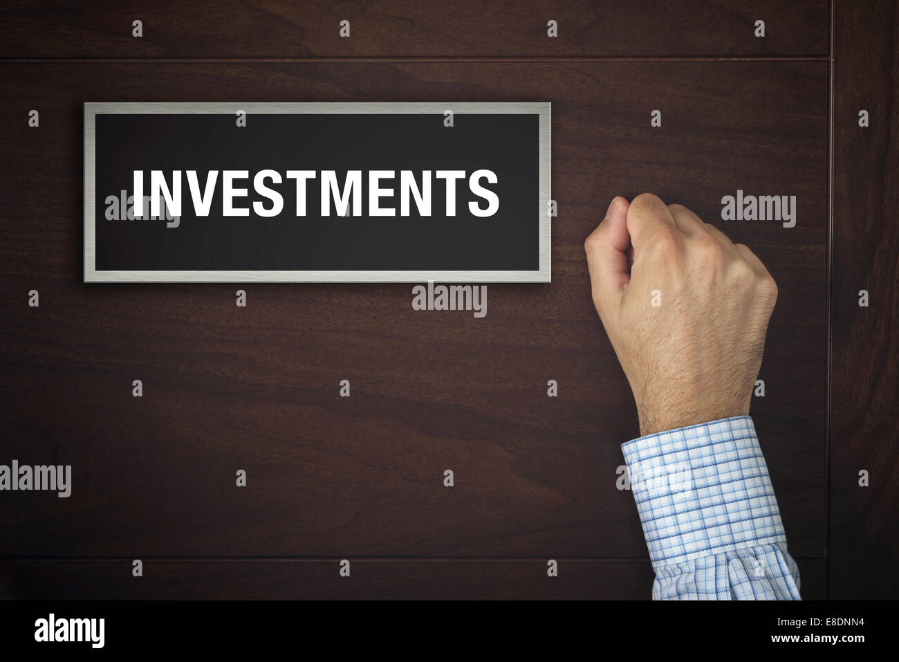 Male hand is knocking on Investments door, conceptual image. - Stock Image