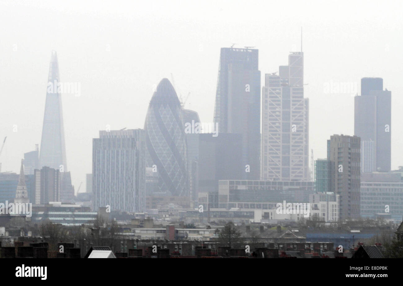 Recognisable London landmarks are shrouded in a thick layer of smog which has blanketed the city for the past few Stock Photo