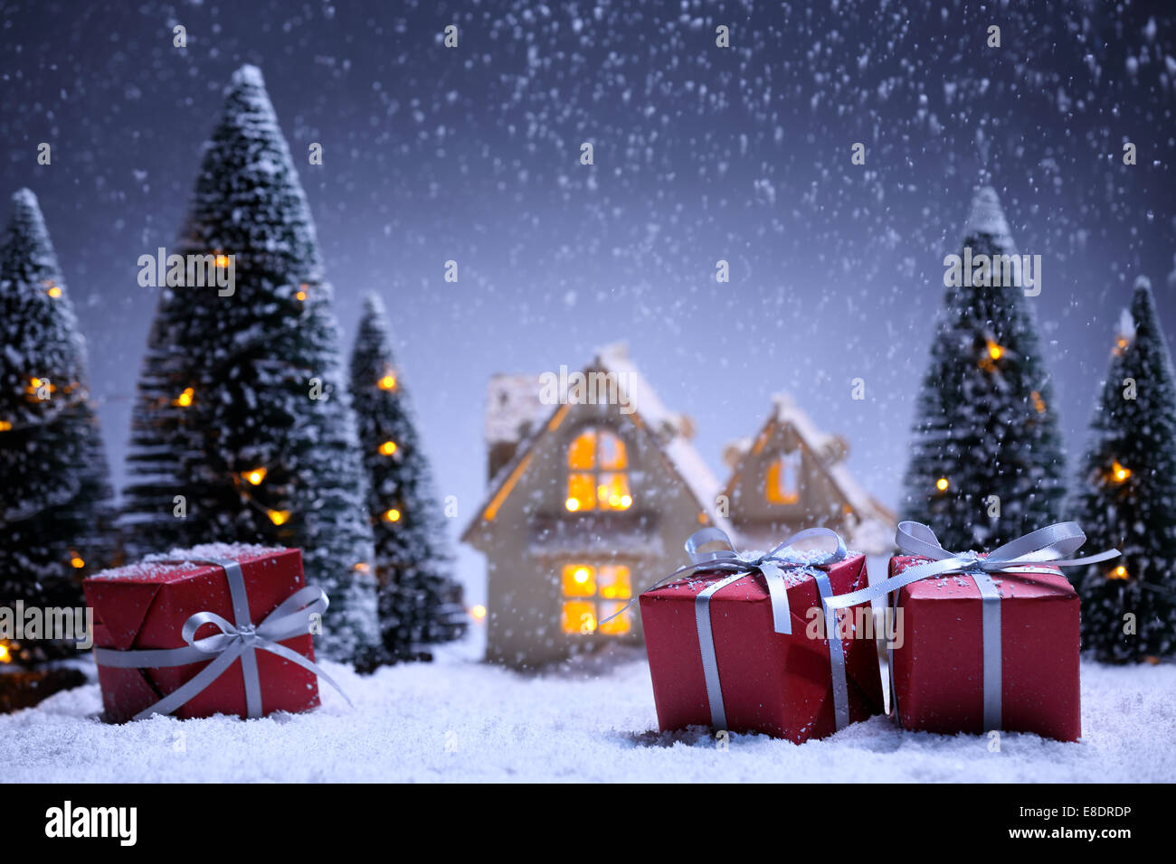 winter scene with Christmas tree,miniature of apartment and gift boxes.Christmas concept. - Stock Image
