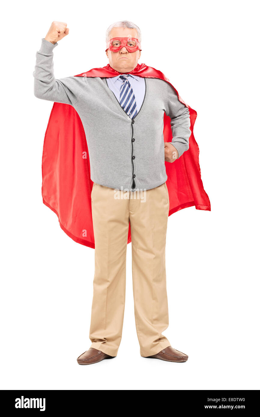 Full length portrait of a proud mature man in superhero costume throwing his fist in the air isolated on white background - Stock Image