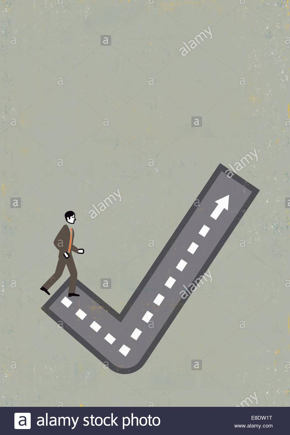 Businessman walking up check mark path - Stock Image