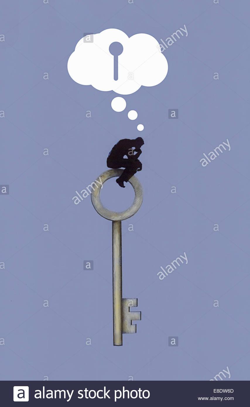 The Thinker sitting on top of large key thinking of keyhole - Stock Image