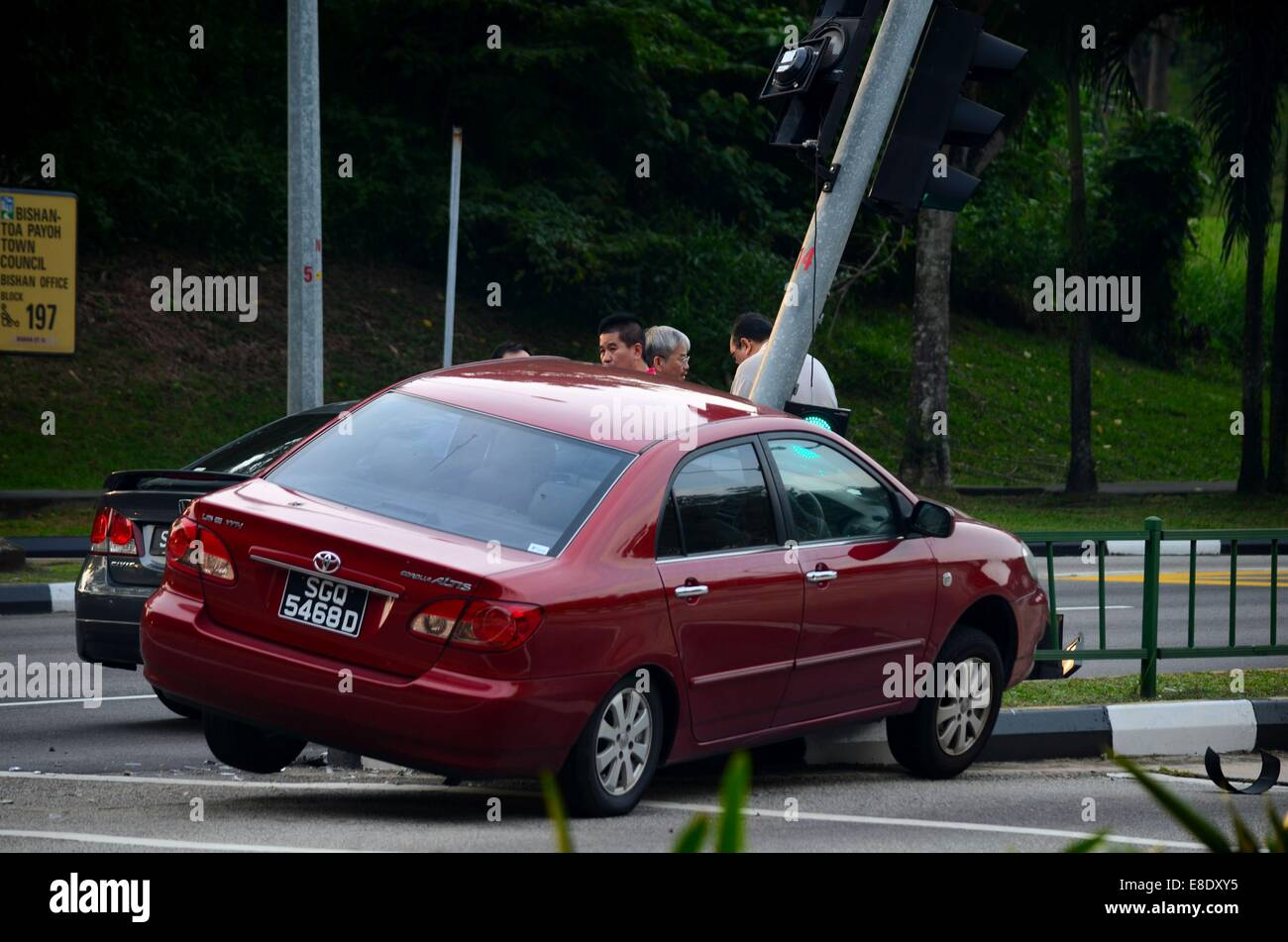 Two car accident on traffic light and divider at Braddell Road intersection Singapore - Stock Image