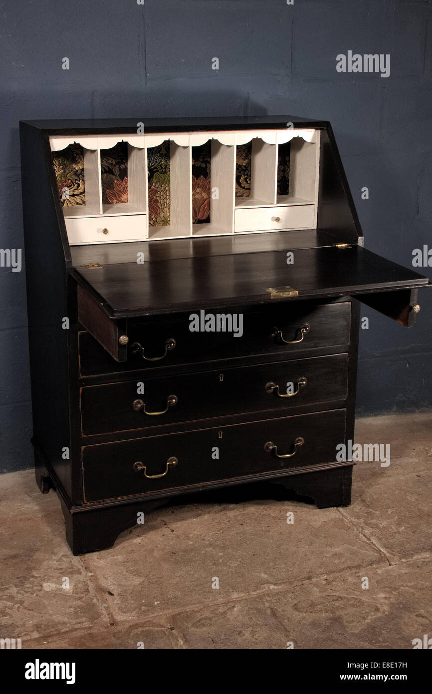 Shabby chic black ebony bureau - Stock Image