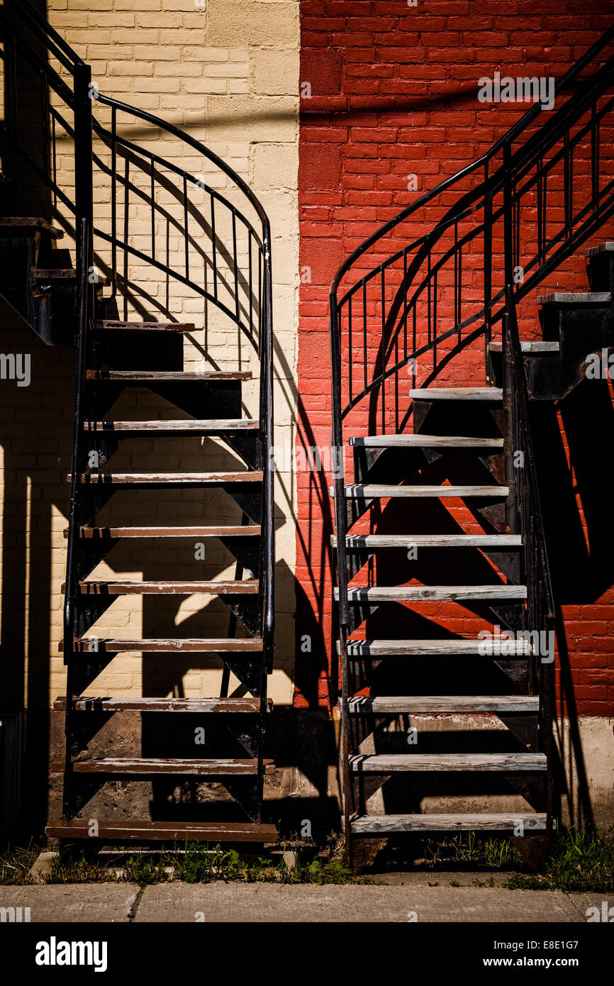 Symmetrical Staircases with two different colors. Red and Beige - Stock Image