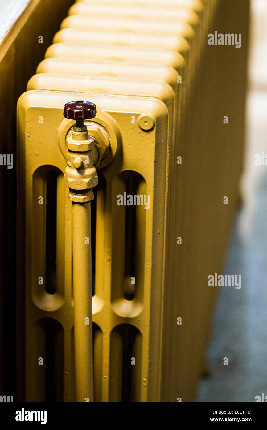 Beige Water Radiator Heater on a Wall - Stock Image