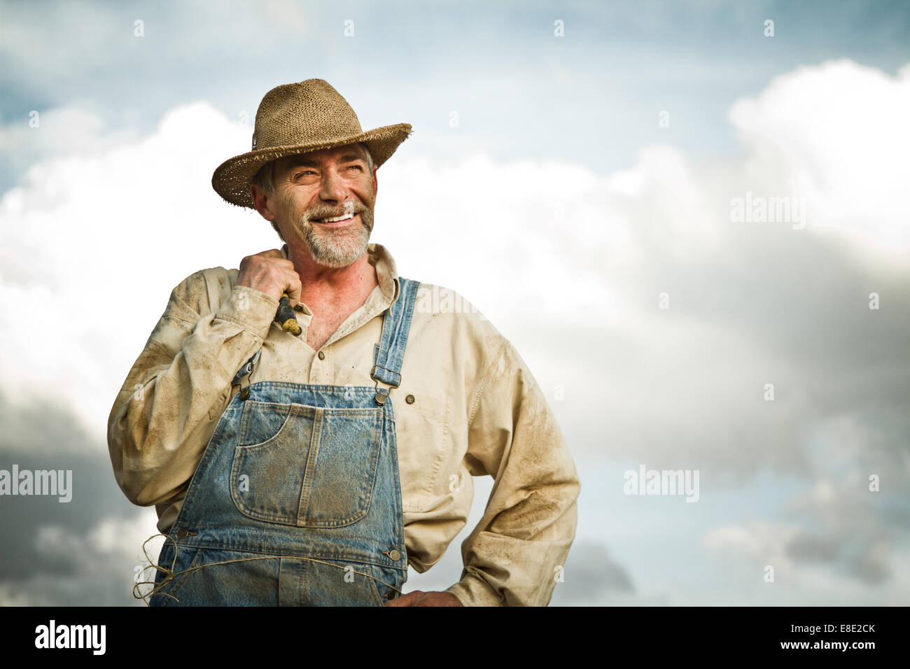 1930s farmer smiling at the Sun - Stock Image