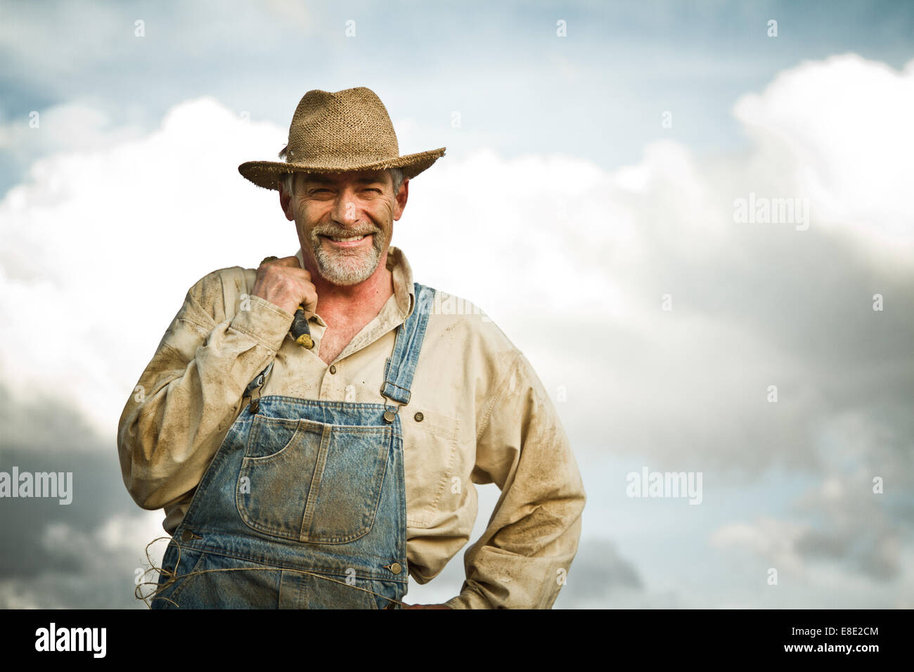1930s farmer smiling at the camera - Stock Image