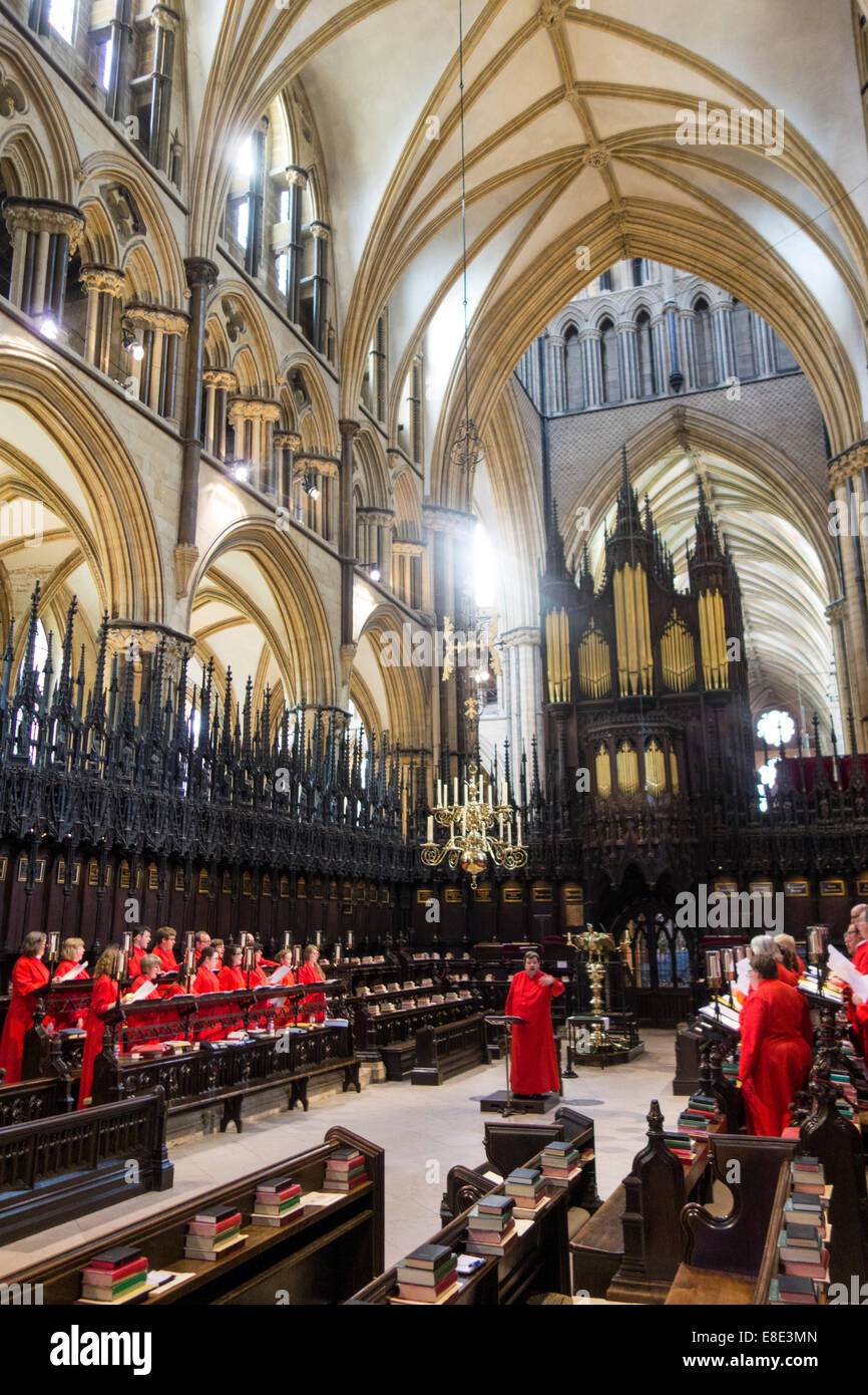 Choir practice inside choir stalls of Lincoln Cathedral in city of Lincolnshire England United Kingdom Stock Photo
