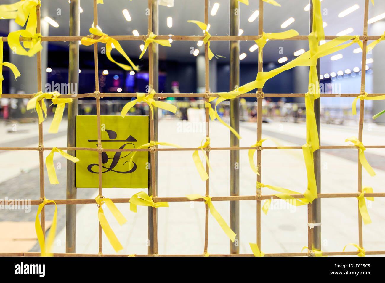Yellow ribbon tied at the gate of the Hong Kong legislative council. - Stock Image