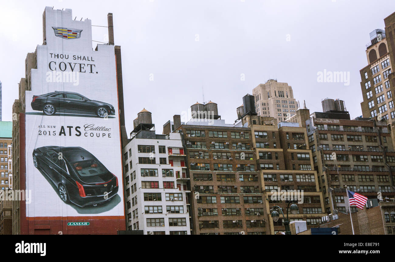 A painted billboard for the General Motors Cadillac line of luxury cars is seen on a building near Penn Station - Stock Image