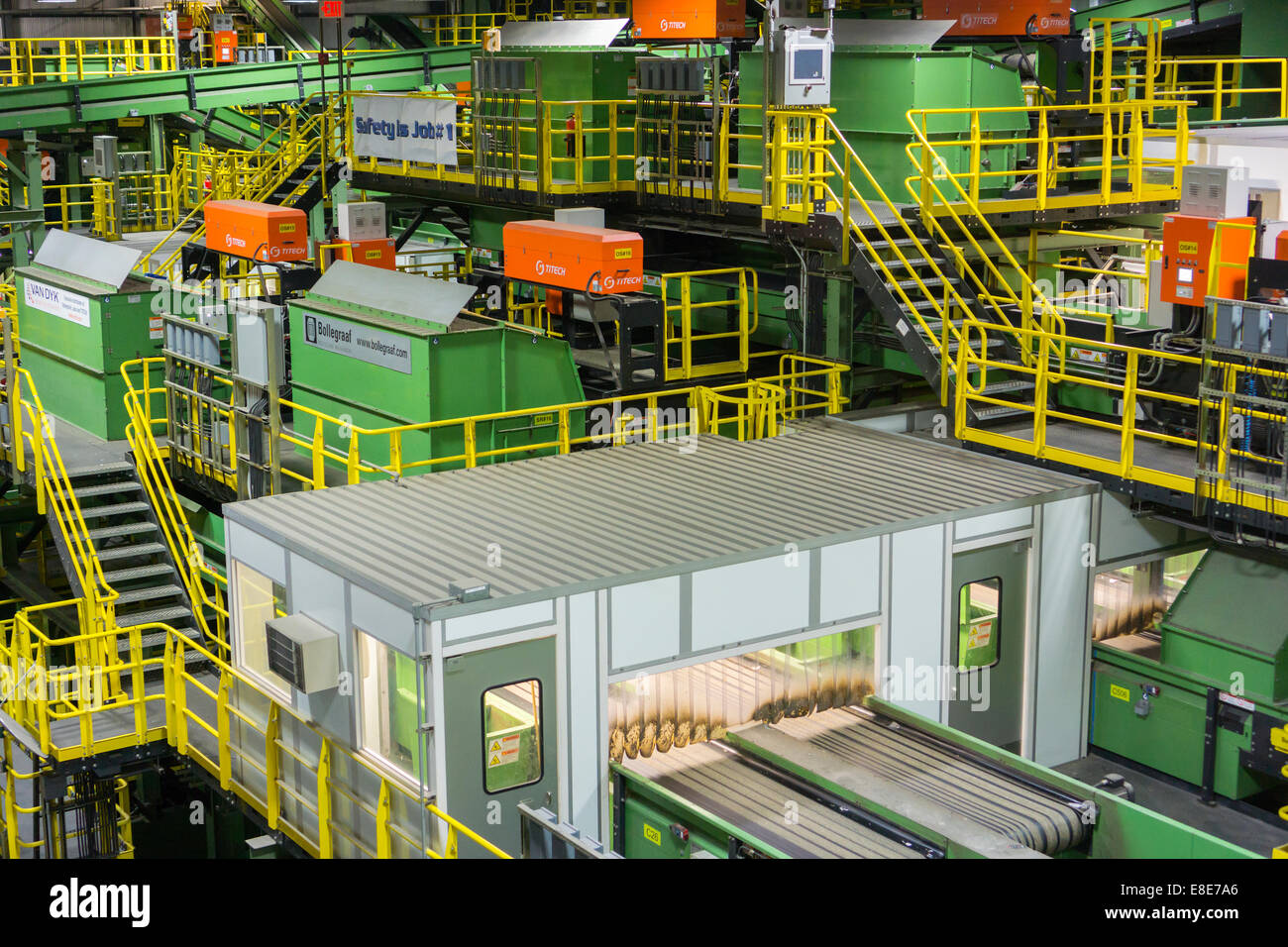 Machinery to process recyclables from the city's curbside recycling program - Stock Image