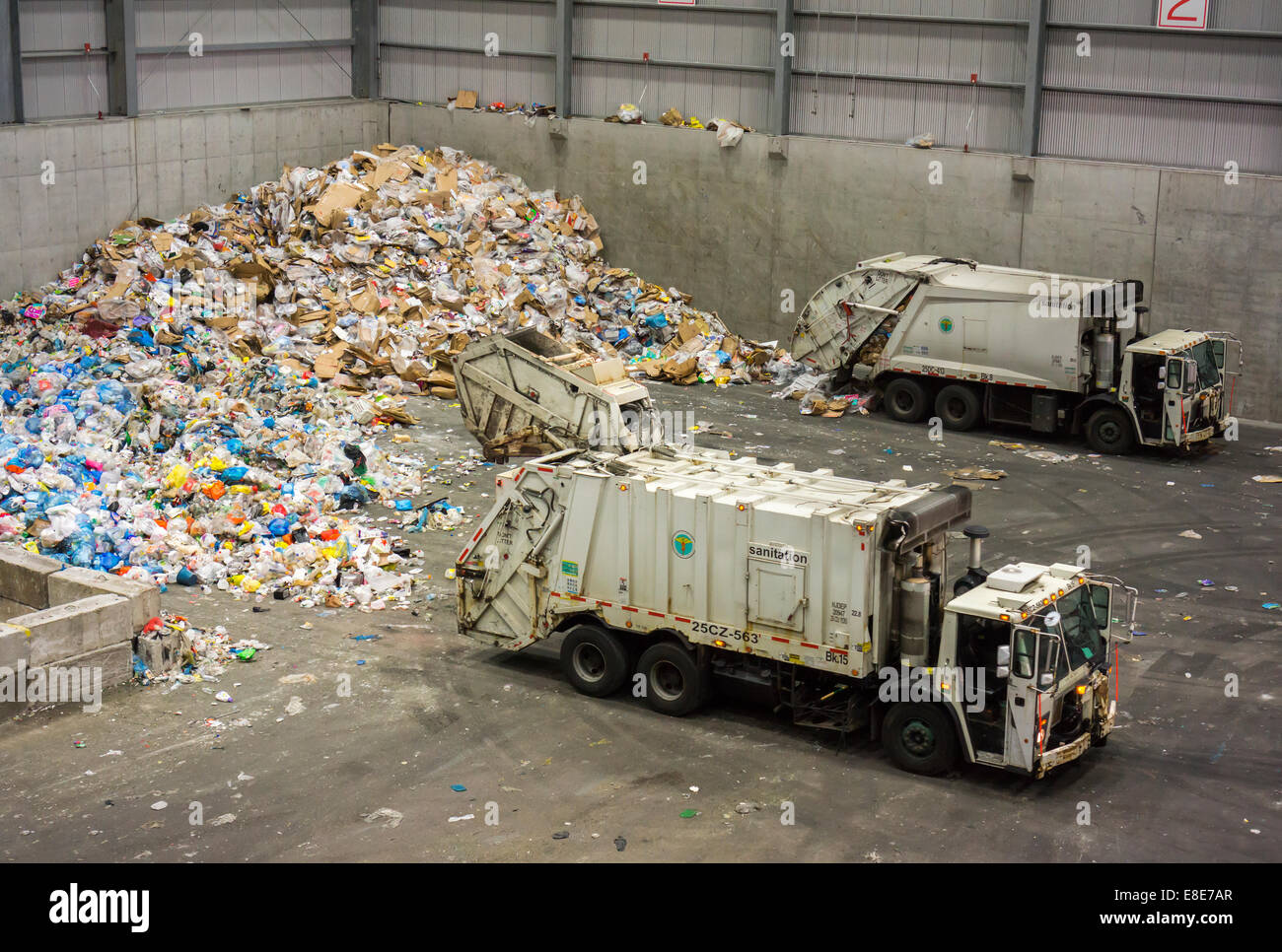 Mountains of trash in the tipping area from the New York's curbside recycling program at the Sims Municipal - Stock Image