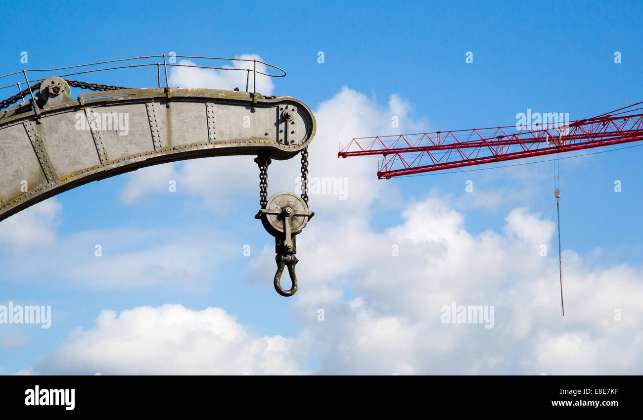 The Fairbairn steam crane on Bristol's floating harbour with modern tower cranes in the distance - Stock Image
