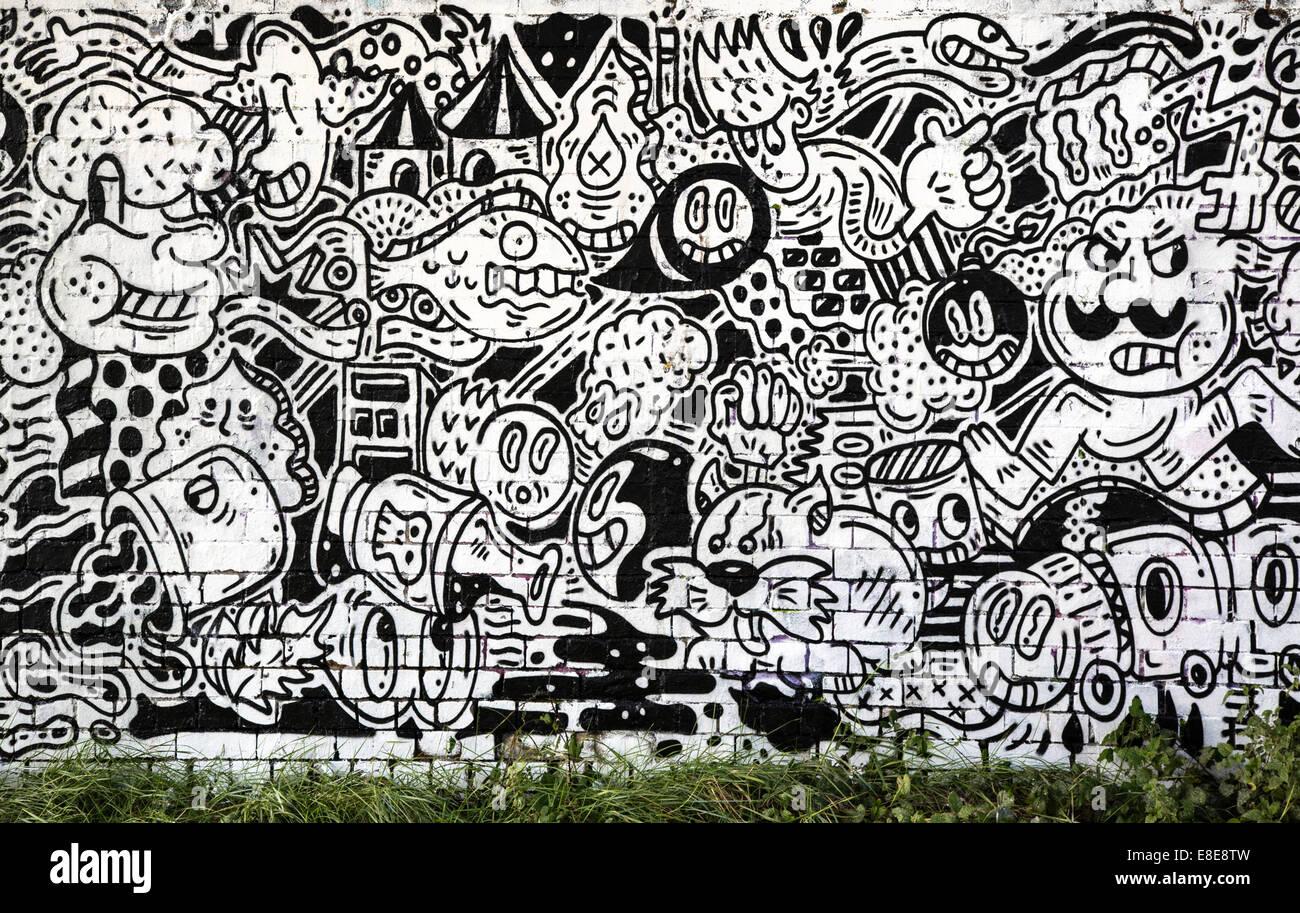 Cartoon graffiti in black and white on a bristol railway bridge uk