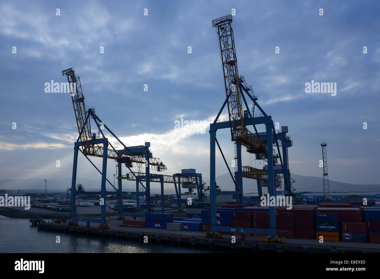 Gantry cranes and shipping containers at Belfast docks UK - Stock Image