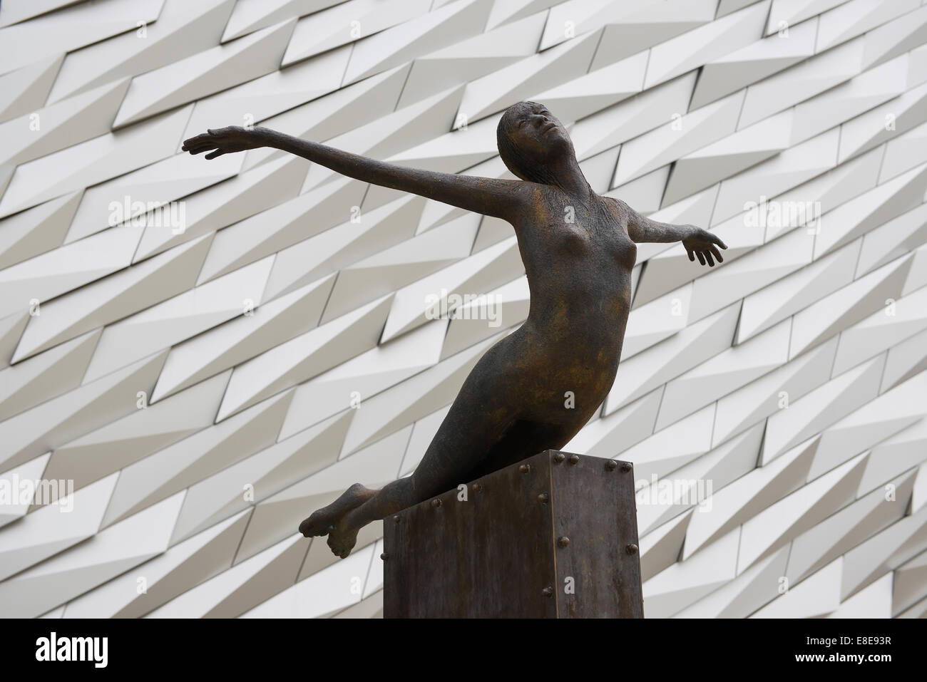 The sculpture Titanica by Rowan Gillespie outside Titanic Belfast - Stock Image