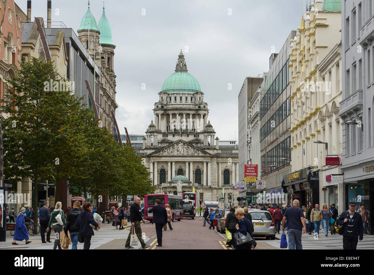 A main shopping street looking towards City Hall in Belfast city centre - Stock Image