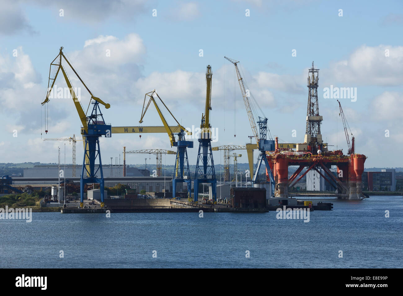 The Harland and Wolff gantry cranes plus the Borgny Dolphin oil rig platform in Belfast Harbour - Stock Image