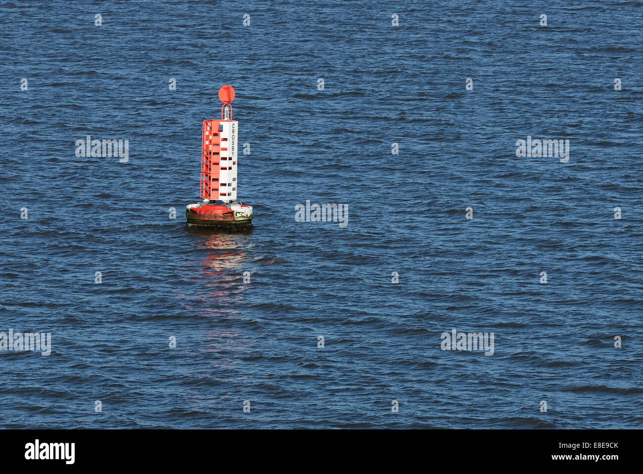 Navigation buoy marking the safe shipping channel in the River Mersey near Crosby Merseyside UK - Stock Image