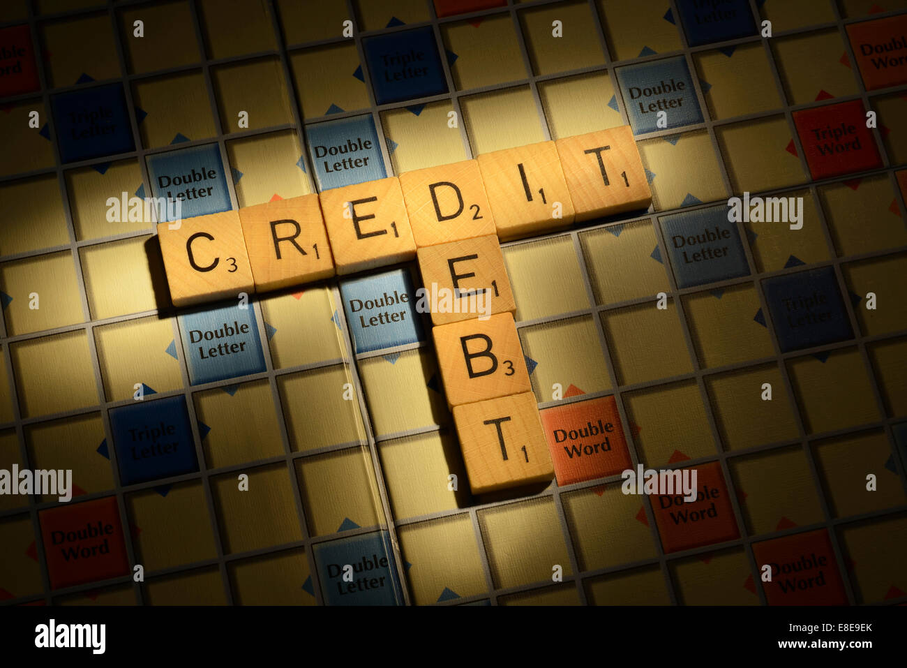 Scrabble board with the words Credit Debt - Stock Image
