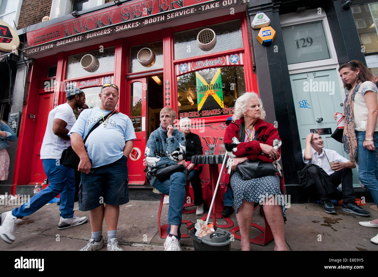 Amusing people sitting outside a Diner in Notting Hill London - Stock Image
