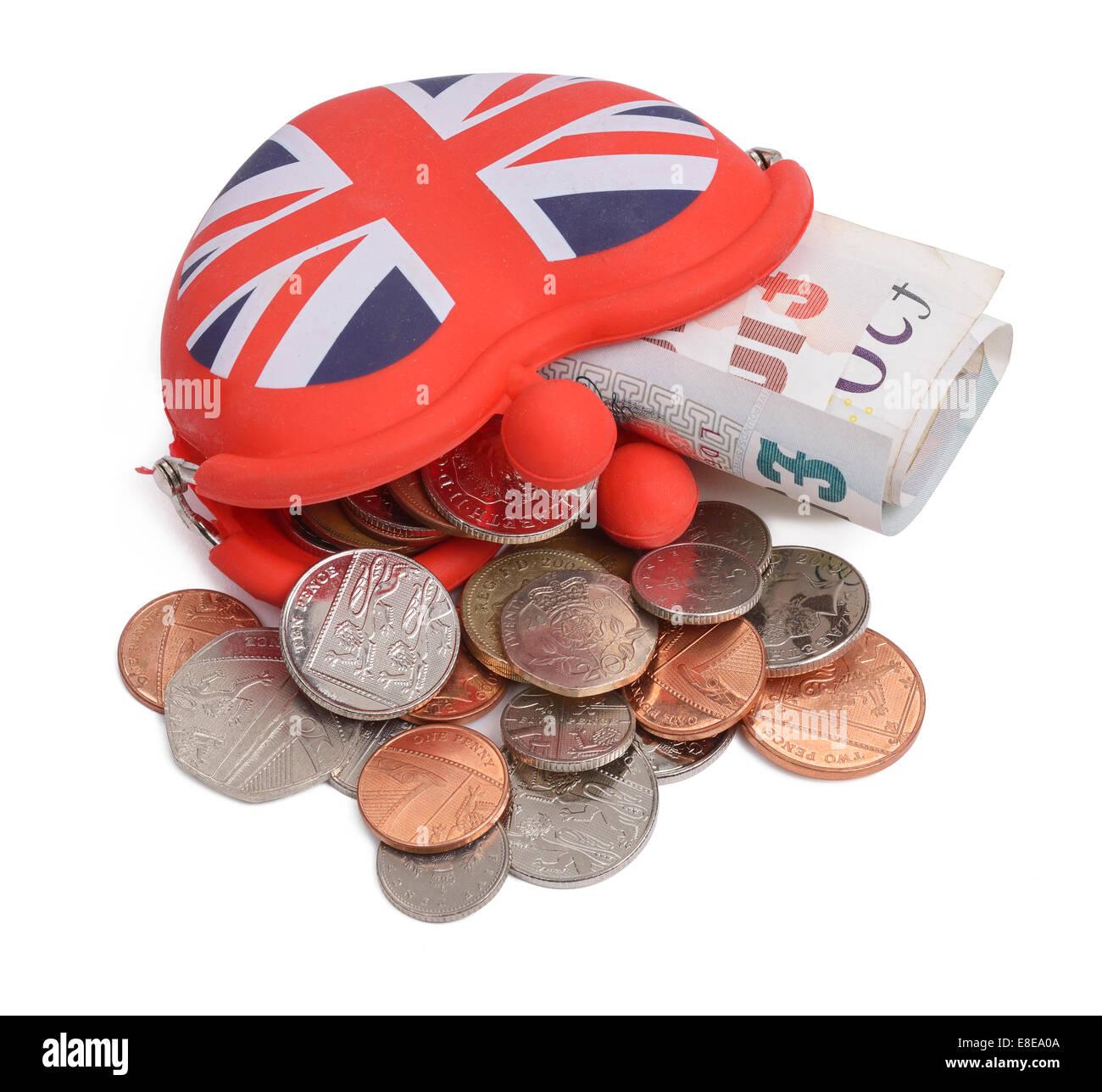 UK purse filled with money - Stock Image
