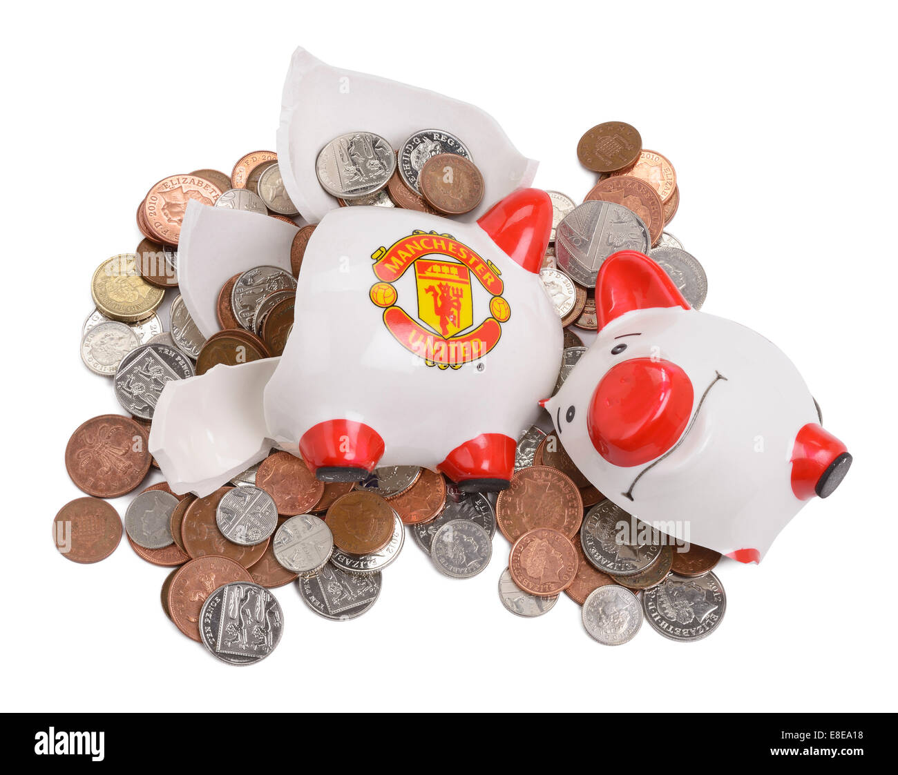 Smashed and broken Manchester United Football Club piggy bank - Stock Image