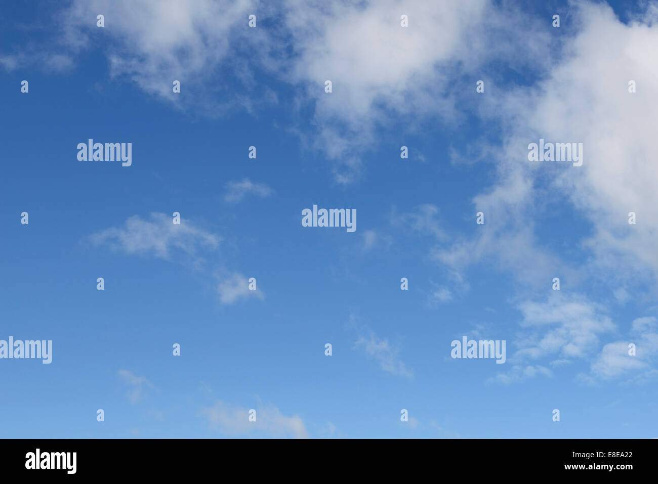 Blue sky with light broken cloud cover - Stock Image