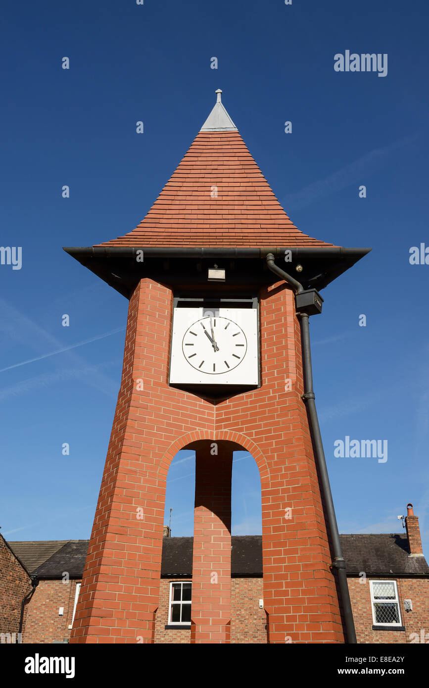 The Millennium clock tower in the centre of Hale village Greater Manchester UK - Stock Image