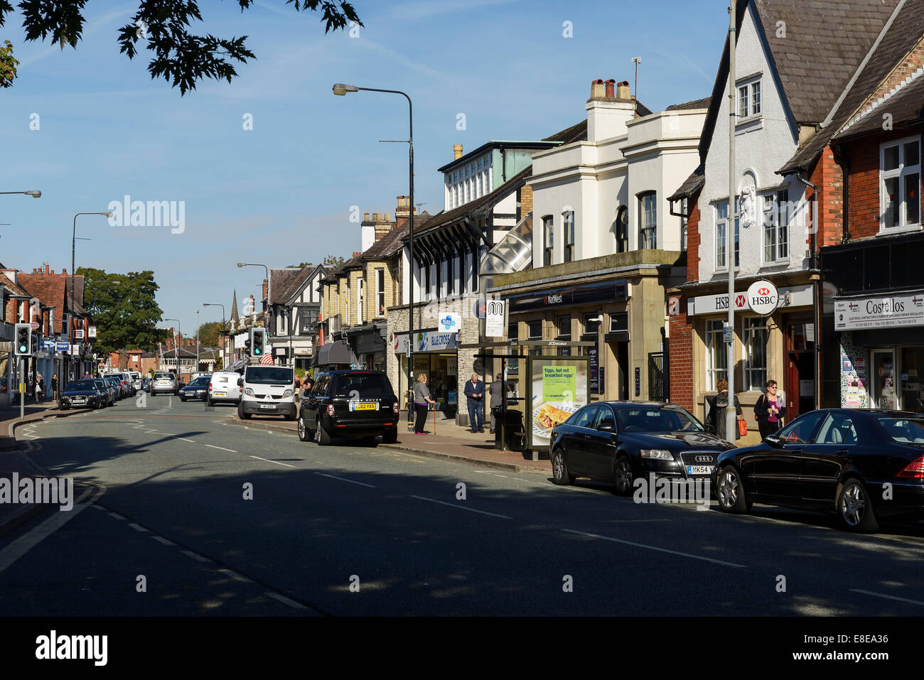 Shops and businesses on Ashley Road in the centre of Hale village Greater Manchester UK - Stock Image