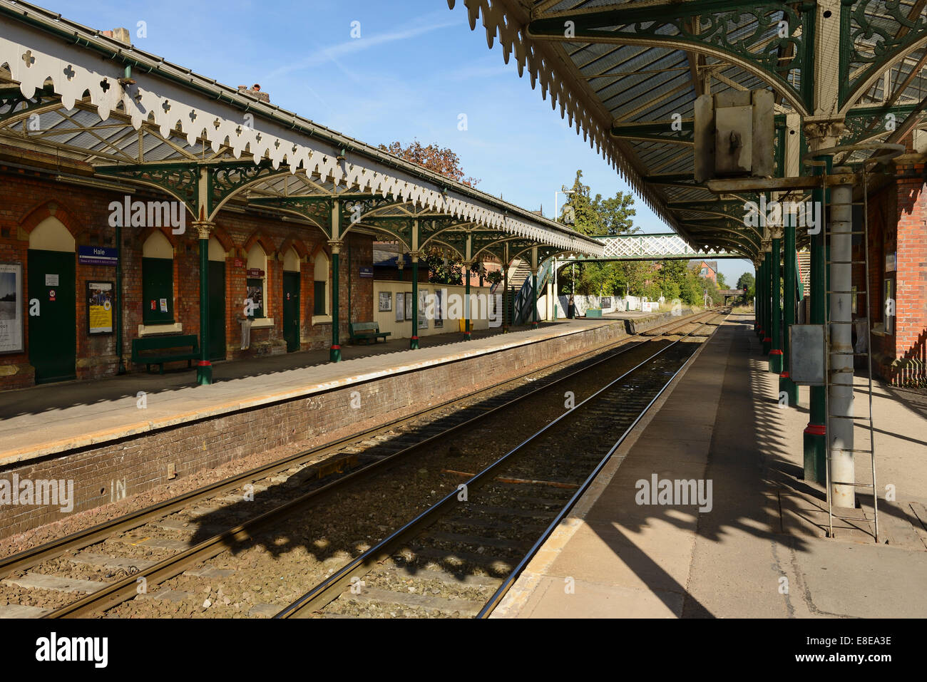 The railway station platforms and decorative canopy at Hale Greater Manchester UK - Stock Image