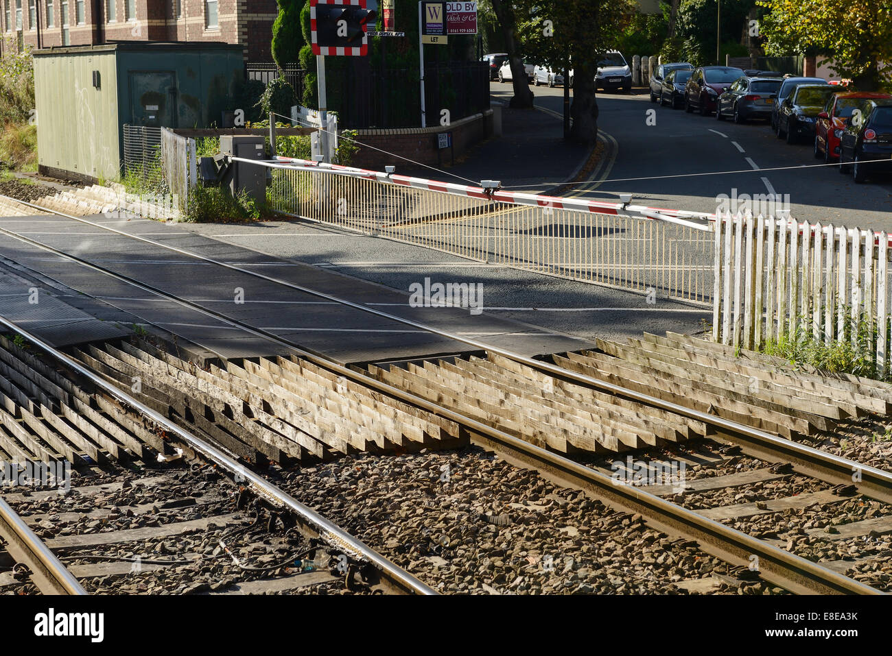 The level crossing at Ashley Road in Hale Greater Manchester UK - Stock Image