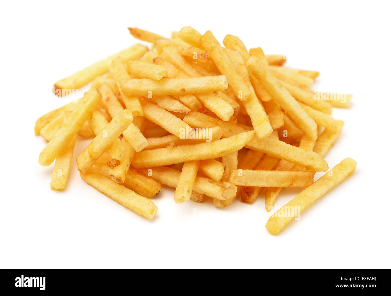 Heap of fried potato chip sticks isolated on white - Stock Image