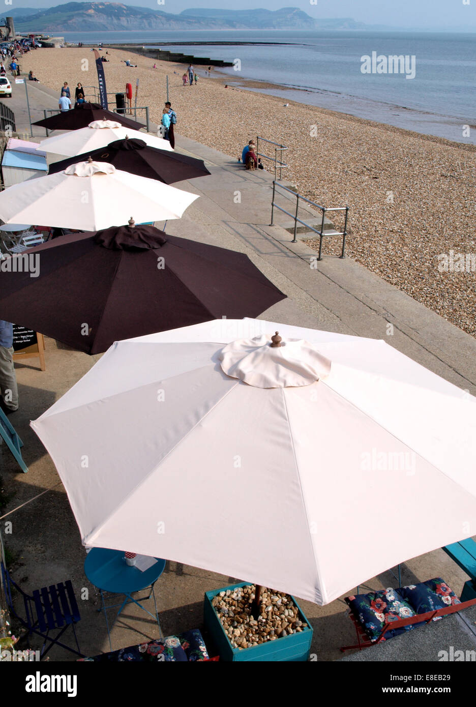 Restaurant outside eating area on the seafront, Lyme Regis, Dorset, UK - Stock Image