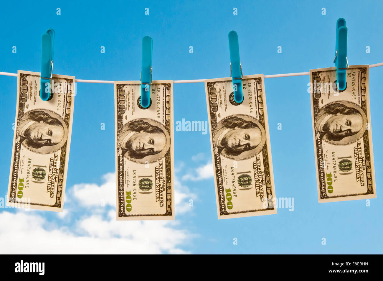 American dollars  hanging on a  rope to dry - money laundering concept - Stock Image