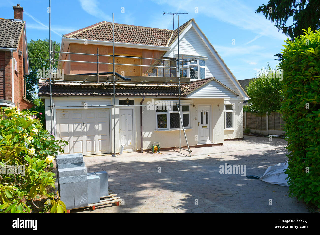 Building work in progress side & front of detached house to add additional timber framed bedrooms & extended - Stock Image
