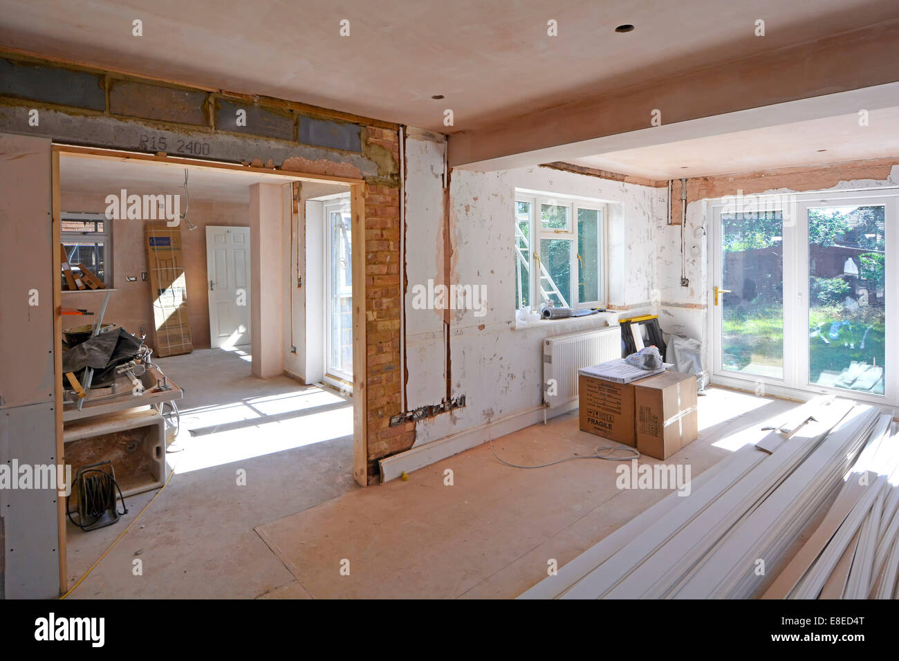 Detached house interior alterations to lounge and dining room (nearest) and side extension for new kitchen (distant) - Stock Image