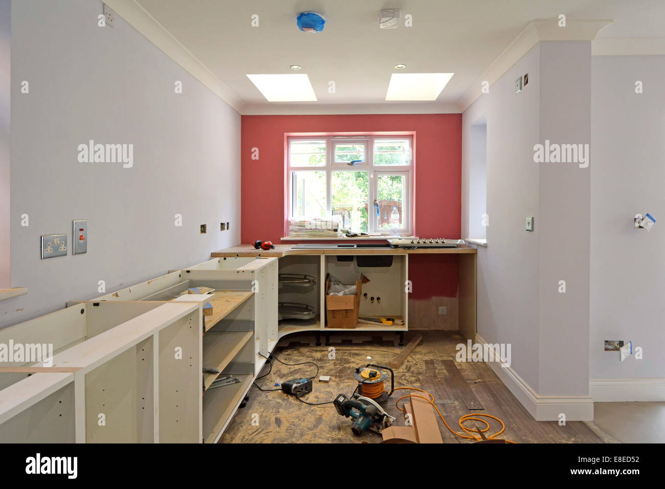 Kitchen Cabinets Being Installed In New Extension To