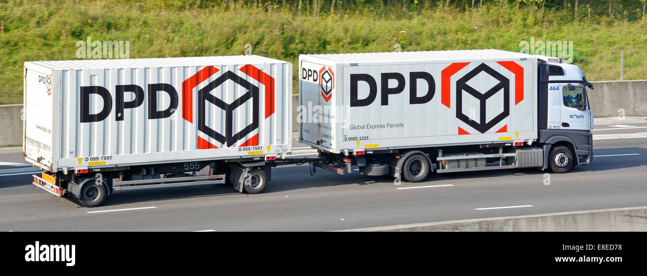 DPD Global Express Parcels lorry and towing trailer driving along