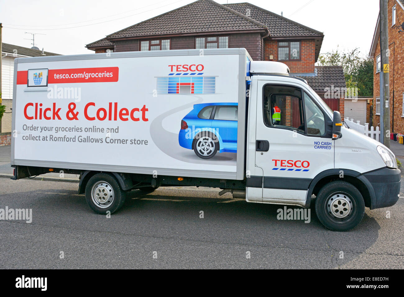 Tesco home delivery van with advert for Click and Collect service from local store - Stock Image