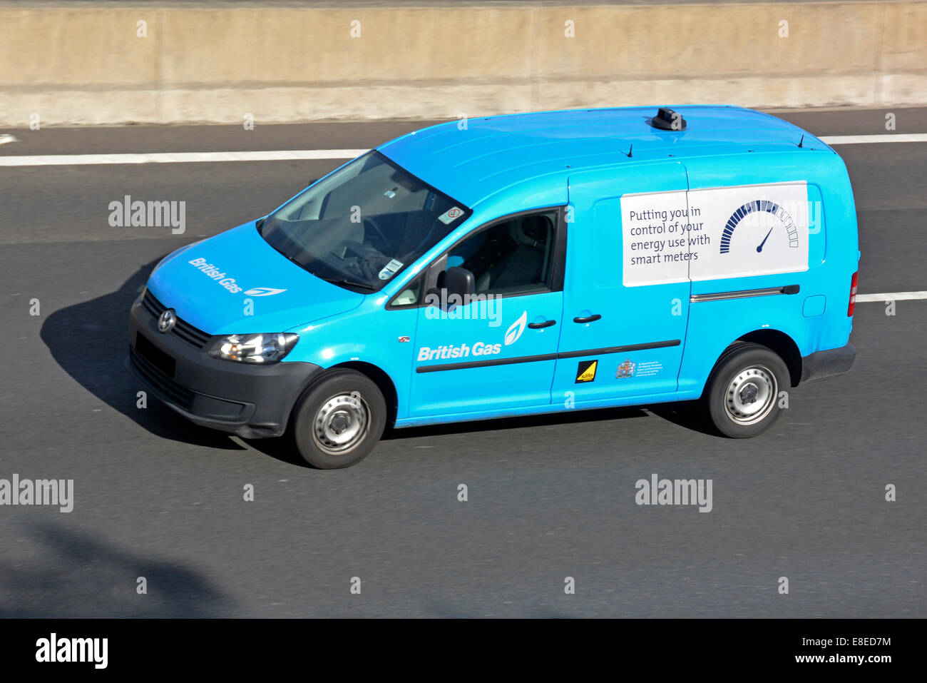 British Gas van driving along motorway with advertising panel promoting smart energy meters (obscured numberplate) - Stock Image