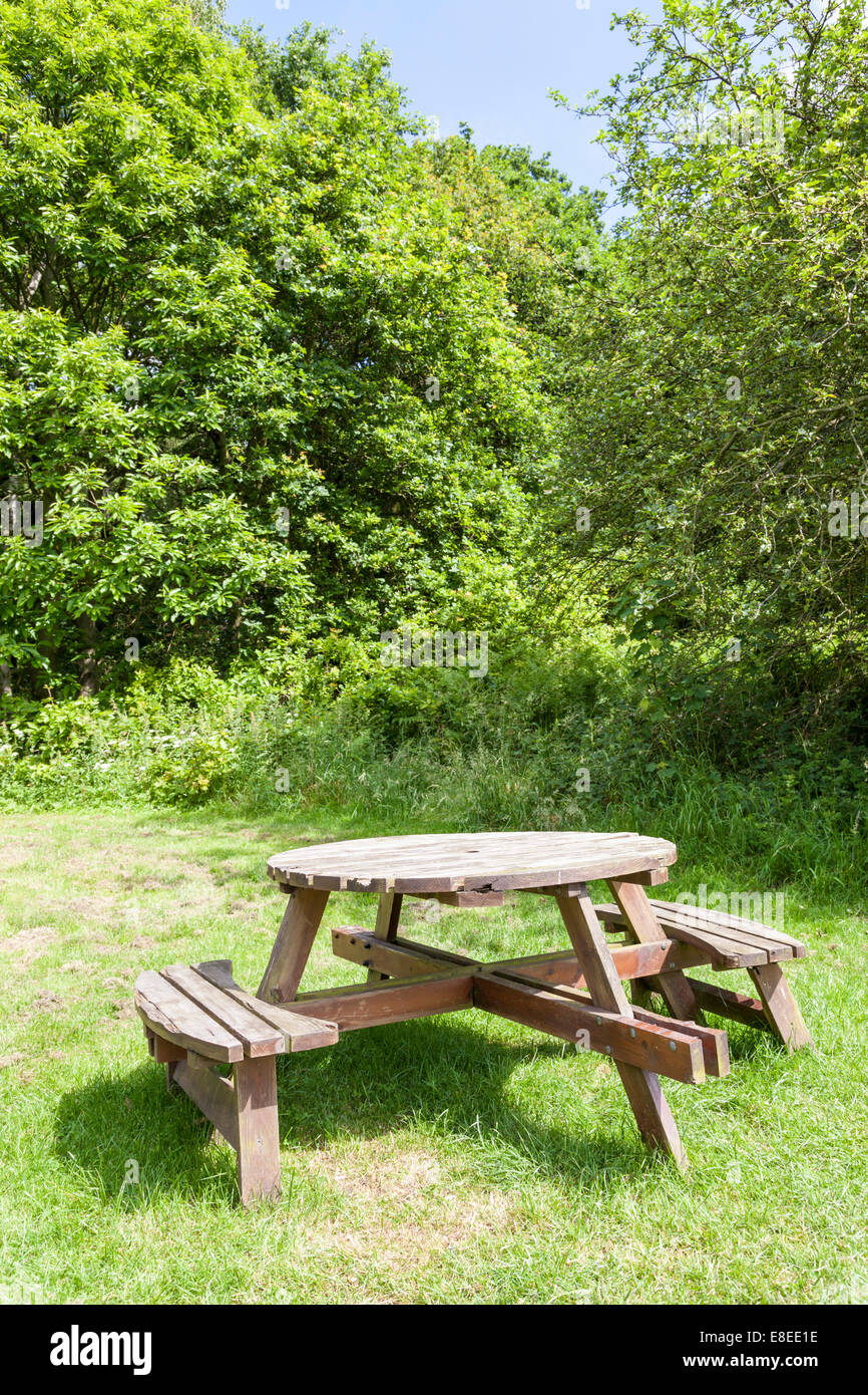 Awesome Round Wooden Picnic Table With Seating In A Field Pabps2019 Chair Design Images Pabps2019Com