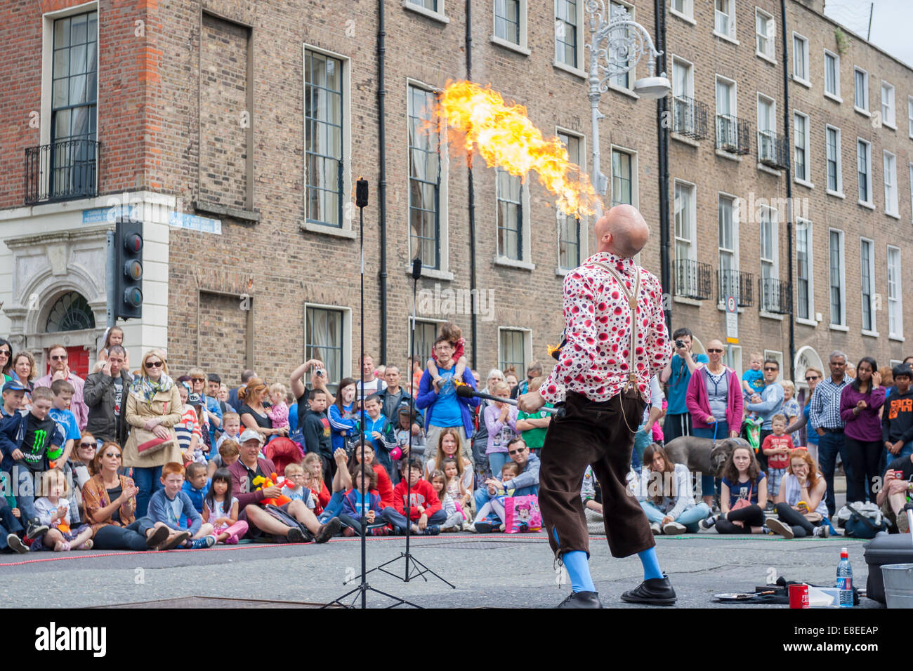 Dublin, Ireland - July 13: Fire-eater spiting fire in The Layal Healthcate City Spectacular Festival at Merrion - Stock Image