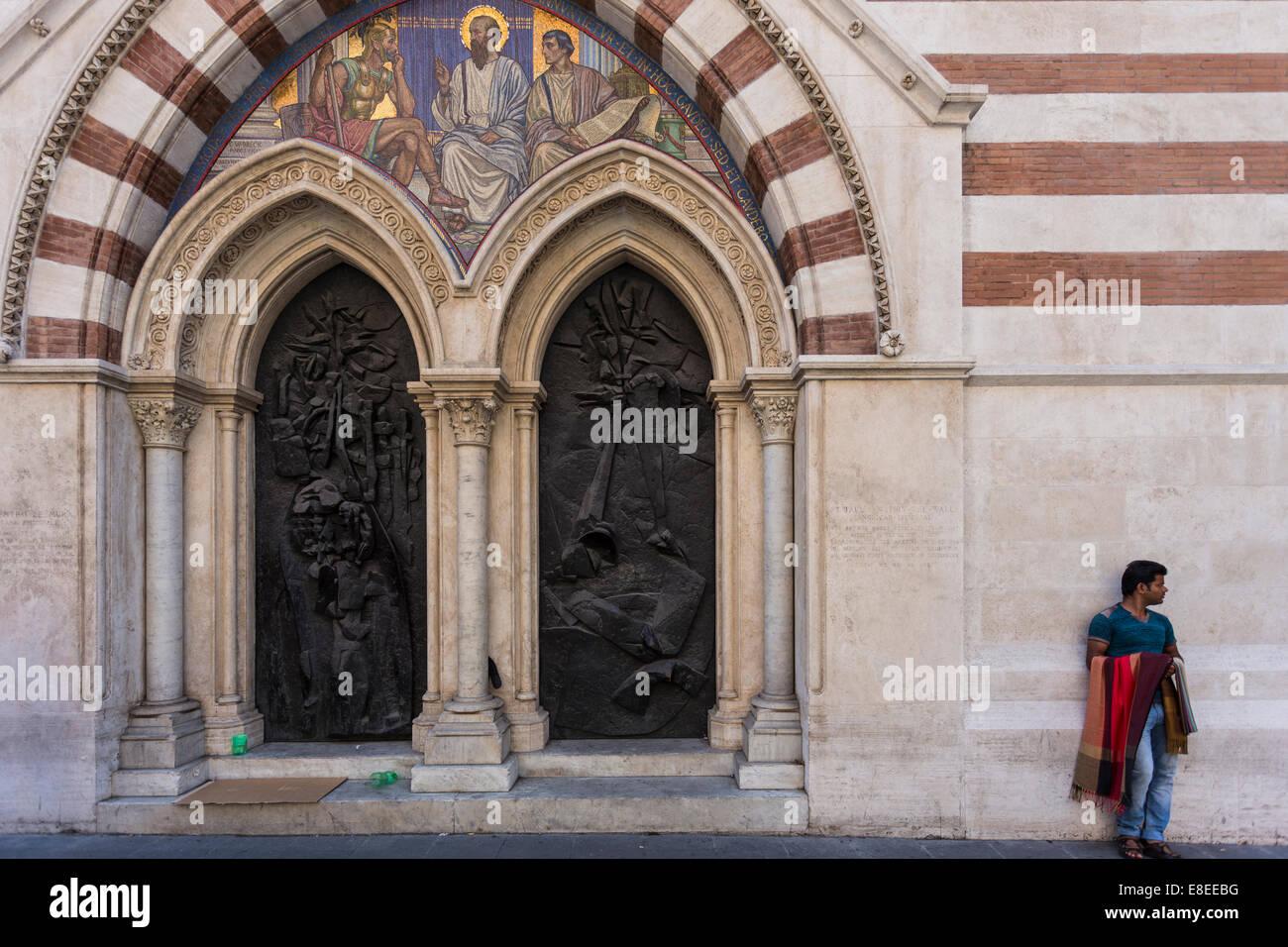 Vendor outside St Paul's Within the Walls (San Paolo dentro le mura, aka American Church in Rome), Rome, Italy Stock Photo
