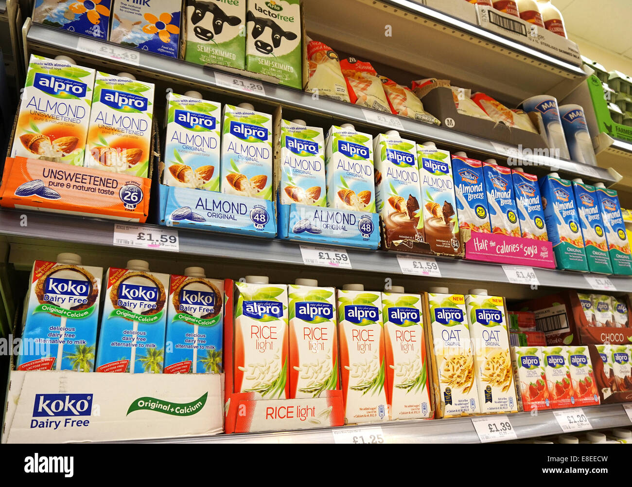 Dairy free Milk products in a uk supermarket - Stock Image