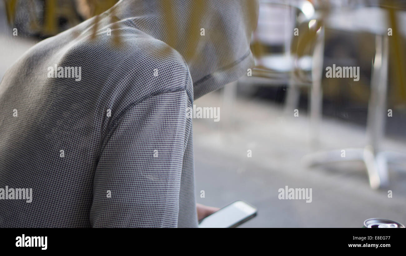 Hoody wearer checking device - Stock Image